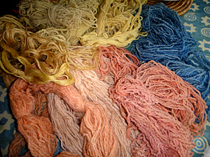 pink, yellow and blue dyed yarn